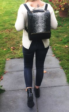 You can see our Daisy backpack with calf leather in black and python leather in black-white from a cuckoo moment...