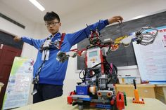 A student controlled a robot with body movements in Weifang in China's Shandong Province. About 80 teams from schools in the city took part in a robot competition.  Zhang Chi/Xinhua/Zuma Press