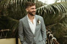 Groom in Open Collar Shirt and Grey Jacket for Beach Wedding | By Rachel Artime Photo | Beach Wedding | Coastal Wedding | Mexico Wedding | Pampas Grass Wedding Decor | Moon Gate for Wedding | Outdoors Wedding | Groom Outfit | Groom Suit | Blush Bridal, Bridal Gowns, Couture Bridesmaid Dresses, Open Collar Shirt, Morning Suits, Groomsmen Suits, Beach Ceremony, Looking Dapper, Groom Outfit
