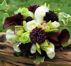 Burgundy, white and green wedding bouquet including roses, orchids, callas, scabiosa and ivy. floralartvt.com