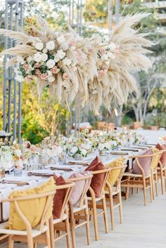 A new wedding trend is having your wedding table centerpieces high, allowing your guests to be able to see each other. #pompasgrass #weddingtrends #reception #boho #bohemianwedding #weddingtablescape #weddingtabledecor