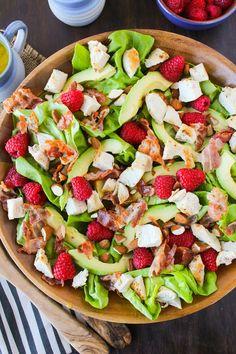 Chopped chicken & raspberry salad with sliced avocado, crispy pancetta, and…