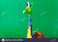 handicraft, craftwork, workmanship, giraffe, camelopard, colorful, colourful, colored, green background Stock Photo