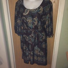 """Brown paisley print shift dress Brand new brown cream and teal paisley printed shift dress with waist tie. Super cute. Size 3x. 95% polyester 5% spandex. 27"""" from armpit to armpit 35"""" from armpit to hem. 3/4 sleeves Fashion Bug Dresses"""