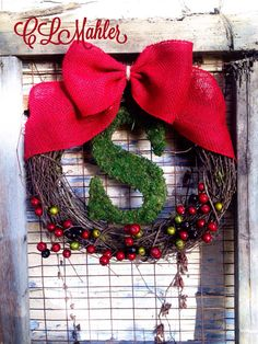 Holly berry and moss monogram Christmas holiday wreath  on Etsy, $50.00