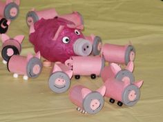 pigs made from film canisters.  Too bad it's so hard to find them now!  The mommy pig is made from a water bottle covered with tissue paper