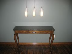 Solid oak sidetable with granite table top    http://www.FollowTheGrain.com