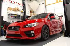 2015 Subaru WRX STI -- not a fan of red but this car is definitely pulling if off!