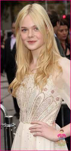 I'm in love with Elle Fanning's dress from the Super 8 Premiere.