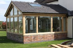 This is one of our Oak framed conservatories. Our team work to ensure that the oak frame is delivered in top condition and ready for a speedy onsite installation at your property. Garden Room Extensions, House Extensions, Conservatory Ideas Sunroom, Oak Framed Extensions, Orangery Extension, Folding Patio Doors, Hot Tub Room, Oak Framed Buildings, Screened Porch Designs
