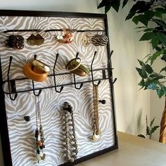 Sassy Khaki Jewelry Frame    Store, display and organize all your jewelry The wall hanging frames serve as both artwork and a practical solution to keeping your jewelry neat, untangled and easy to find.    Frames hold earrings, bracelets, watches, bangles, rings, and necklaces. | Sassy Khaki Jewelry Frame, via Flickr.