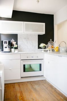 hardwood floors and modern cabinets httpwwwstylemeprettycomliving2016072530 dream kitchen moments thatll make you want to renovate