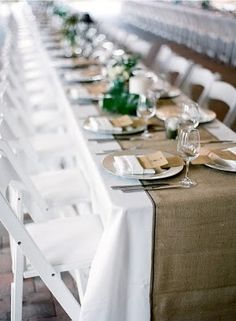 "burlap runner, white table cloth paired with white americana chairs and simple centrepieces looks elegant rather than ""rustic"" (Carly)"
