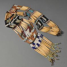 Plains Woman's Hairpipe Necklace |  Bone hairpipes alternating with a variety of large glass trade beads and with brass tack decorated commercial leather spacers | ca. late 19th century | 861$ ~ Sold