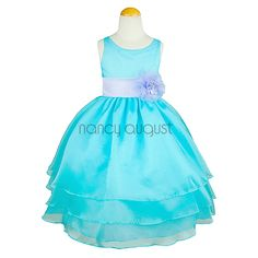 Turquoise Organza Flower Girl Dress: This elegant turquoise organza flower girl dress features a sensational sleeveless style with a triple layer skirt. This beautifully simple white organza tea length dress comes with a adjustable sash tie in the back. Like many of our special occasion dresses, it is versatile and can be used as a flower girl dress, pageant dress, or even as a first communion dress.