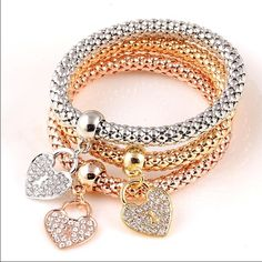 Set of 3 bracelets 1 gold 1 rose gold 1 silver with crystal heart charms. Stretchy for comfort and fit Boutique Jewelry Bracelets