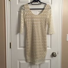 Chelsea & Violet Lace Dress Chelsea & Violet cream lace 3/4 length dress. Worn once. Sleeves are sheer, body has a cream underlay. Chelsea & Violet Dresses Long Sleeve