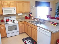 Mickey Mouse themed kitchen. I like that it is more subtle than others, but it needs more color. Like red walls.