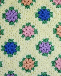 """Watch us review this beautiful Vintage Granny Popcorn Afghan Crochet Pattern! Design by: Maggie Weldon Skill Level: Intermediate Size: Afghan = 46"""" (115 cm) X 64"""" (160 cm), Each Motif = 5-1/2 """" (14 cm                                                                                                                                                                                 More"""