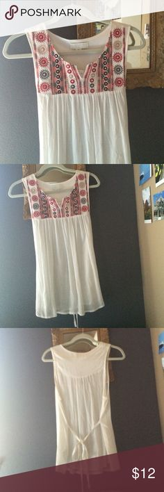 Forever 21 Boho Top Forever 21 Boho Top, pretty white flowing sleeveless top with red, gray, tan and silver boho design on top.  New with Tags!  Ties in back for feminine touch.  Very Pretty!  Size XL Forever 21 Tops Tunics