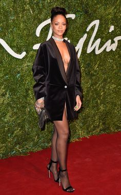 Rihanna spices up the carpet in this chic number at the British Fashion Awards 2014
