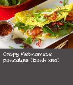 """In Vietnamese, banh xeo means """"sizzling cake"""" for the sound the pancake batter makes when added to the hot pan. Inspired by the Vietnamese community in the Sydney suburb of Marrickville, this recipe packs a fresh and flavoursome punch. Vietnamese Pancakes, Vietnamese Recipes, Vietnamese Food, Crispy Batter Recipe, Lunch Meals, Lunch Recipes, Banh Xeo, Pound Cake Recipes, Butter Recipe"""