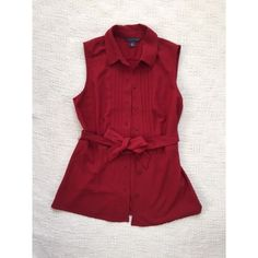 "HP x 2 Tommy Hilfiger Button Down Blouse Red Tommy Hilfiger Button Down Blouse Wine Red, sleeveless button shirt. In great condition. Host Pick 1/18/16 ""best in tops"" and in the ""casual chic"" on 2/02/16.   Open to offers. Tommy Hilfiger Tops Button Down Shirts"