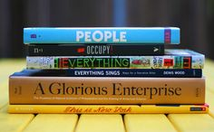 "book spine poetry: ""people occupy everything / everything sings a glorious enterprise / this is new york"""