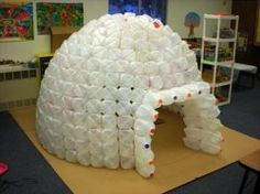 Igloos are cool. You can easily build a milk jug igloo with some planning, lots of milk jugs and hot glue.    For example, the children in Classroom 1 at Midland Christian School (Midland, Michigan) built the 428-jug igloo shown here after collecting (and cleaning) milk cartons for about 3 weeks. This medium-sized igloo is large enough to hold about 8 to 10 kindergardeners or first graders.  This is super cool!  start saving those milk jugs.. what a great play house for the back yard and if ...