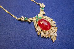 Ruby, diamond, emerald brooch in 9K gold, India.