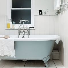 my scandinavian home: A beautiful white cottage by the sea. Love the blue round bottom of bath.