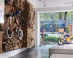 Spread by Gum - bike shop with wall made of 5,412 recycled paper tubes that be moved a million different ways to shelve or cradle items (inspired by pin toys)