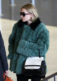 Ashley Olsen arrived at the airport in Paris in an oversize fur coat.
