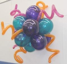 How to add curly balloons to a balloon bouquet or balloon topiary.