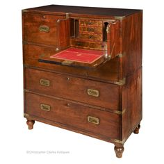 A mahogany, Secretaire Campaign Chest attributable to Gregory Kane of Dame Street, Dublin. This chest has a short secretaire drawer with the fall front opened by a single, sprung clip button to the righthand side. Stow On The Wold, Campaign Furniture, Secret Compartment, Drawer Fronts, Drawers, Dublin, Wood, Interior, Desks