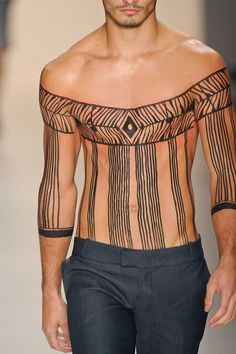 I think this is just drawn on him for some fashion show-thing, but it's a cool idea.