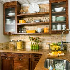 Reeded-glass cabinet fronts, open shelves, and to-the-ceiling tile keep the look open and airy. The homeowners found the tile—along with the faucets and cork flooring—on eBay.