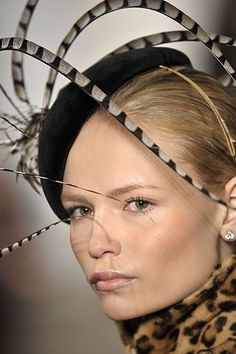 Love the swooping pheasant feathers ~  Ralph Lauren - I think Stephen Jones did the hats. FW 2008