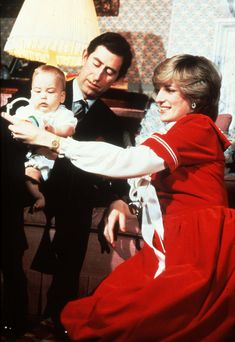 Princess Diana and Prince Charles with little Prince William at Kensington Palace in December 1982.