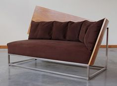 by Katie Walker, the curved hardwood back is the perfect contrast for plush chocolate seating. Au courant and divine.