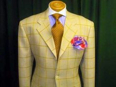 Cream/Gold Tone Jacket with Gold Tie and White Shirt, a nice blend/combination.