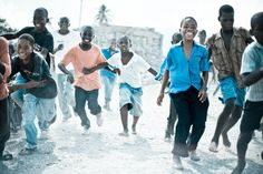 Haitian kids having fun playing red light green light - Les Anglais - Haiti by Mason Boring
