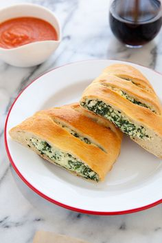 Spinach and Ricotta Calzones - I would probably go with the lighter version of the cheeses here, but still looks great!
