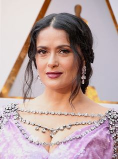 2018 Oscars - Salma Hayek  Loose trendrils, braids, and a plum lipstick on Salma Hayek.