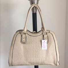 "🇺🇸FINAL🇺🇸🆕Brand New Crmy Cadence handbag 👜 Brand New Handbag, with tags, never carried• Only ONE of this color and style available!👜 -Brand: boutique/sold by Cali&Karma (retails for $92) -Color: cream with gold hardware  -Dimensions: 14"" length, 10"" height, 5"" width -Details: back pocket, interior pocket, two interior pouches, snap closure, textured design -Other: last one available‼️will not be restocked/open to OFFERS via Posh's offer button :) **soft animal friendly VEGAN LEATHER…"