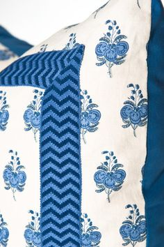 We love this #blueandwhite pillow with decorative tape trim.  You cannot go wrong with #RaoulTextiles