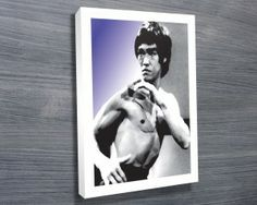 Bruce Lee Pop art Canvas Print from $26.00. The 2nd of our Bruce Lee canvas art prints, this iconic photo makes a great wall art piece and is the perfect gift for any Martial Arts fans! http://www.canvasprintsaustralia.net.au/  #CanvasprintBrisbane #photosoncanvasPerth  #CanvasprintsMelbourne