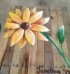 Yellow flower painted on reclaimed pallet wood