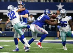 New York Giants quarterback Eli Manning, second from left, gets rid of the ball before getting tackled by Dallas Cowboys cornerback Orlando Scandrick (32) in the second half of an NFL football game, Sunday Sept. 11, 2016, in Arlington, Texas.