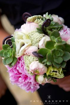 the coordinating bridesmaids bouquet with mirrored succulents with pink peonies and fiddlehead ferns